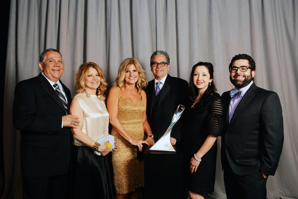 The Venegas family accepting the 2016 GM Supplier of the Year award for Ideal Setech